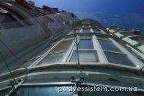 Стеклянный козырек для балкона